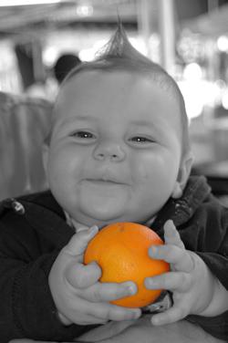 Baby With Orange