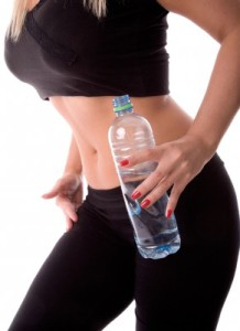 Very fit woman with water bottle