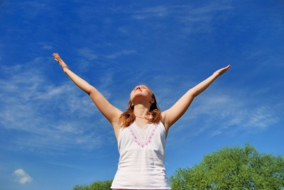 Woman with arms stretched overhead   FearlessFatLoss.com